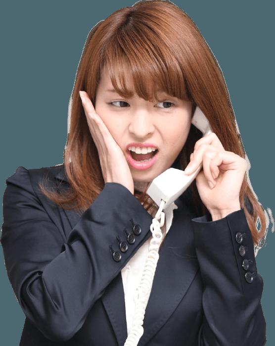 し写真:電話に出る女性